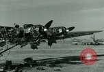 Image of Wreckage of German Me-323 transport airplane at El Aouina airfield Tunis Tunisia, 1943, second 12 stock footage video 65675020479