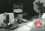 Image of men in bar Germany, 1941, second 7 stock footage video 65675020685