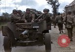 Image of Allied troops advancing through ruins and beach obstacles Valognes France, 1944, second 4 stock footage video 65675020907