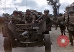 Image of Allied troops advancing through ruins and beach obstacles Valognes France, 1944, second 5 stock footage video 65675020907