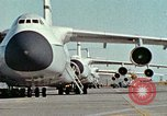 Image of  F-5E Tiger II fighters being loaded on C-5 transport aircraft California United States USA, 1976, second 1 stock footage video 65675021081
