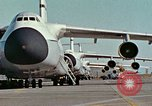 Image of  F-5E Tiger II fighters being loaded on C-5 transport aircraft California United States USA, 1976, second 2 stock footage video 65675021081