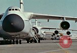 Image of  F-5E Tiger II fighters being loaded on C-5 transport aircraft California United States USA, 1976, second 3 stock footage video 65675021081