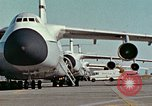 Image of  F-5E Tiger II fighters being loaded on C-5 transport aircraft California United States USA, 1976, second 5 stock footage video 65675021081
