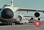 Image of  F-5E Tiger II fighters being loaded on C-5 transport aircraft California United States USA, 1976, second 6 stock footage video 65675021081