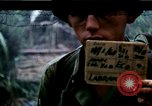 Image of U.S. Army 196th Lt Inf Brigade knock down damaged building wall Vietnam, 1968, second 1 stock footage video 65675021200