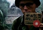 Image of U.S. Army 196th Lt Inf Brigade knock down damaged building wall Vietnam, 1968, second 2 stock footage video 65675021200