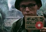 Image of U.S. Army 196th Lt Inf Brigade knock down damaged building wall Vietnam, 1968, second 6 stock footage video 65675021200