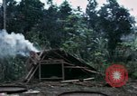 Image of U.S. Army 196th Lt Inf Brigade knock down damaged building wall Vietnam, 1968, second 12 stock footage video 65675021200