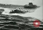 Image of World War II amphibious assault in Pacific Pacific Theater, 1944, second 6 stock footage video 65675021727