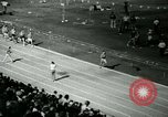 Image of Jim Ryun breaking world record mile Bakersfield California USA, 1967, second 11 stock footage video 65675021956