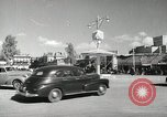 Image of Traffic policeman under umbrella Baghdad Iraq, 1942, second 2 stock footage video 65675022192