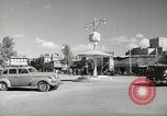 Image of Traffic policeman under umbrella Baghdad Iraq, 1942, second 4 stock footage video 65675022192