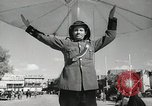 Image of Traffic policeman under umbrella Baghdad Iraq, 1942, second 8 stock footage video 65675022192