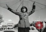 Image of Traffic policeman under umbrella Baghdad Iraq, 1942, second 9 stock footage video 65675022192