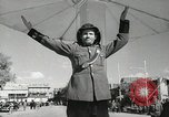 Image of Traffic policeman under umbrella Baghdad Iraq, 1942, second 10 stock footage video 65675022192