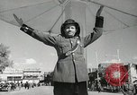 Image of Traffic policeman under umbrella Baghdad Iraq, 1942, second 11 stock footage video 65675022192