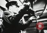 Image of Officers inside Japanese two-man midget submarine Pacific Theater, 1941, second 8 stock footage video 65675022276