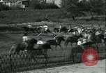 Image of Young children riding horses Kansas City Missouri USA, 1934, second 12 stock footage video 65675022443
