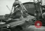 Image of burning abandoned and wrecked cars New York City USA, 1958, second 12 stock footage video 65675022487