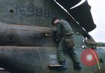 Image of United States Marines salvage parts from a helicopter Vietnam, 1968, second 10 stock footage video 65675022557