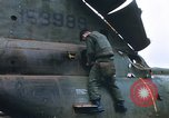 Image of United States Marines salvage parts from a helicopter Vietnam, 1968, second 12 stock footage video 65675022557