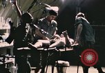 Image of wounded United States soldier Vietnam, 1969, second 9 stock footage video 65675022607