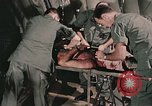 Image of wounded United States soldier Vietnam, 1969, second 9 stock footage video 65675022608