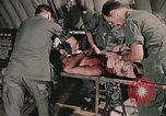 Image of wounded United States soldier Vietnam, 1969, second 10 stock footage video 65675022608