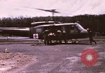 Image of operation on wounded soldier Vietnam, 1969, second 4 stock footage video 65675022610