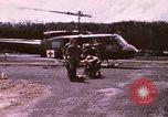 Image of operation on wounded soldier Vietnam, 1969, second 12 stock footage video 65675022610