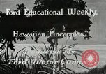 Image of Hawaiian pineapple workers resting Hawaii USA, 1916, second 2 stock footage video 65675022621