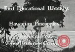 Image of Hawaiian pineapple workers resting Hawaii USA, 1916, second 4 stock footage video 65675022621