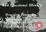 Image of Hawaiian pineapple workers resting Hawaii USA, 1916, second 8 stock footage video 65675022621