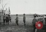 Image of US Army troops and band marching with flag during training United States USA, 1916, second 6 stock footage video 65675022632