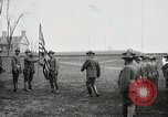 Image of US Army troops and band marching with flag during training United States USA, 1916, second 7 stock footage video 65675022632
