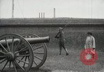 Image of US Army soldier shows cannon to woman United States USA, 1916, second 5 stock footage video 65675022633
