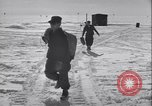 Image of Man distributes goods from container Sierra Greenland, 1954, second 10 stock footage video 65675022806