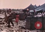 Image of U.S. Marine bivouac area Palau Islands, 1944, second 10 stock footage video 65675022886