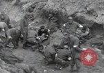 Image of Medics tend to wounded U.S. soldiers on beach Normandy France, 1944, second 9 stock footage video 65675022977