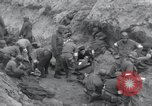 Image of Medics tend to wounded U.S. soldiers on beach Normandy France, 1944, second 10 stock footage video 65675022977