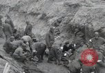 Image of Medics tend to wounded U.S. soldiers on beach Normandy France, 1944, second 11 stock footage video 65675022977