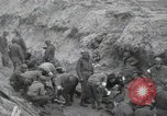 Image of Medics tend to wounded U.S. soldiers on beach Normandy France, 1944, second 12 stock footage video 65675022977