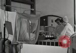 Image of baby in oxygen tent Detroit Michigan USA, 1936, second 6 stock footage video 65675023151
