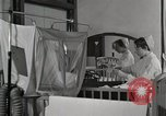 Image of baby in oxygen tent Detroit Michigan USA, 1936, second 8 stock footage video 65675023151
