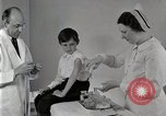 Image of Doctor vaccinates boy Detroit Michigan USA, 1936, second 8 stock footage video 65675023153