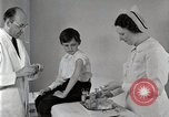 Image of Doctor vaccinates boy Detroit Michigan USA, 1936, second 9 stock footage video 65675023153