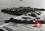 Image of trains and trucks at German military port Kerch Crimea, 1941, second 6 stock footage video 65675023586