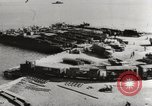 Image of trains and trucks at German military port Kerch Crimea, 1941, second 7 stock footage video 65675023586