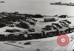 Image of trains and trucks at German military port Kerch Crimea, 1941, second 11 stock footage video 65675023586